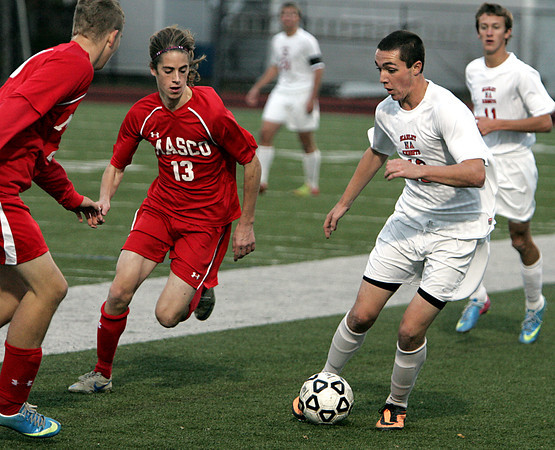 Lynn:<br /> North Andover's John Enright, right, has Masconomet's Max Craig coming in from his side while moving the ball down field during the North Andover vs. Masco boys soccer North final at Manning Field in Lynn.<br /> Photo by Ken Yuszkus / The Salem News, Monday, November 11, 2013.