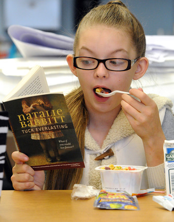 Salem:<br /> Student Amber Grant reads while eating her breakfast in her classroom at the Carlton Elementary School. The Salem Public Schools have started a grant-funded breakfast in the classroom program.<br /> Photo by Ken Yuszkus / The Salem News, Friday, November 22, 2013.