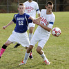 Topsfield:<br /> Danvers' Chris Davis, left, and Masco's Justin D'Orlando go after the ball during the Danvers at Masconomet boys soccer in Division 2 North quarterfinals.<br /> Photo by Ken Yuszkus / The Salem News, Tuesday, November 5, 2013.