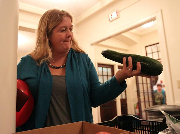 Salem: Salem resident Emily Froeschl picks out a zucchini at the Winter Salem Farmer's Market inside the old City Hall on Thursday afternoon. David Le/Salem News