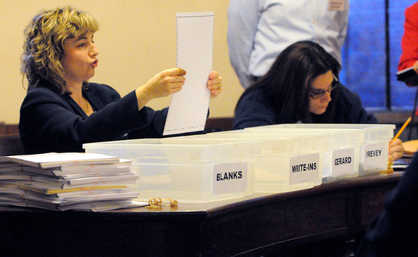 Salem:<br /> Assistant city clerk Ilene Simons reads out the name on one of the ballots during the election ballot recount at Salem City Hall. Councilor Paul Prevey requested a recount of the ballots from Nov. 5.<br />  Photo by Ken Yuszkus / The Salem News, Monday, November 25, 2013.
