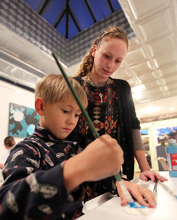 Beverly: Emily Pallin, founder and Art Director of Let's Get Creative in Beverly, helps DJ Corbett, 6, of Beverly, during an after school class on Thursday evening. David Le/Salem News