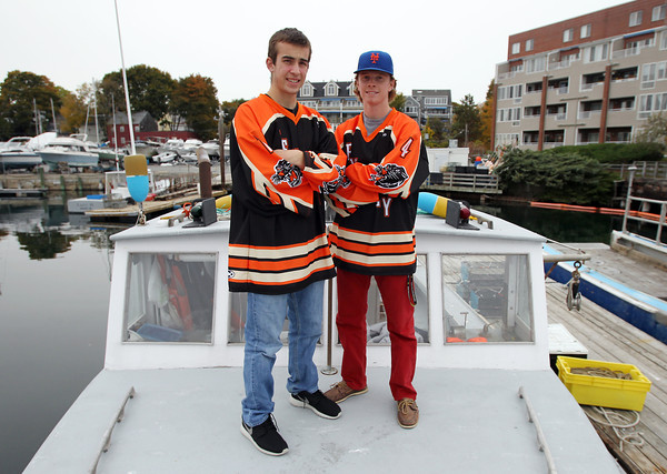 Beverly: Beverly High School juniors Tim Biarelli, left, and Ted Leathersich, are best friends who work together lobstering on Biarelli's boat. The friends go out every day during the summer and on the weekends during the school year. Biarelli, the Panthers starting goaltender, and Leathersich, one of the Beverly forwards, will lead the Panthers in the 2013-2014 campaign. David Le/Salem News