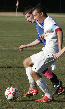 Topsfield:<br /> Danvers' Mark McCarthy, left, and Masco's Daniel Raphael battle for the ball during the Danvers at Masconomet boys soccer in Division 2 North quarterfinals.<br /> Photo by Ken Yuszkus / The Salem News, Tuesday, November 5, 2013.