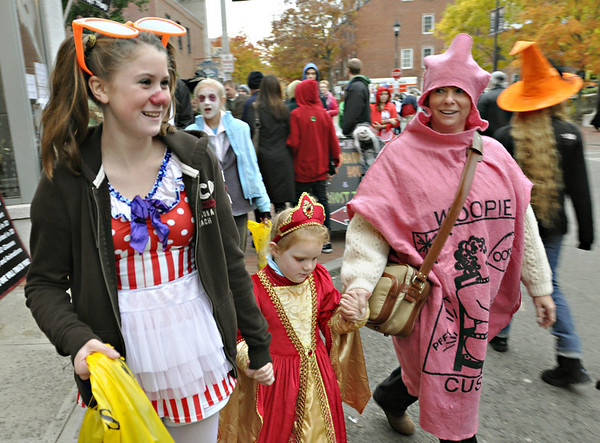 Salem: 12-year-old Tori Stitz, left, walks along Essex St. Saturday evening with her sister Maddie, 4, and mother Beth from Ramsey, New Jersey.