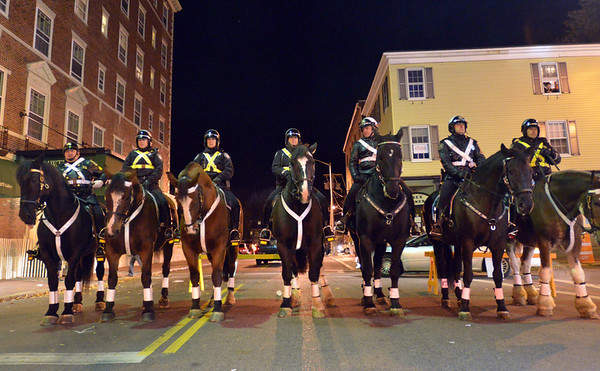 Salem: Police on horseback prepare to clear the streets. photo by Mark Teiwes / Salem News