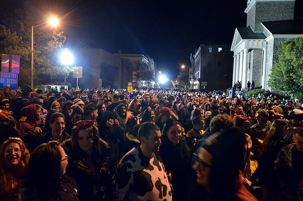 Salem:  As the Halloween celebration comes to a close, crowds pack Washington St. from Bridge St. to Essex St. photo by Mark Teiwes / Salem News