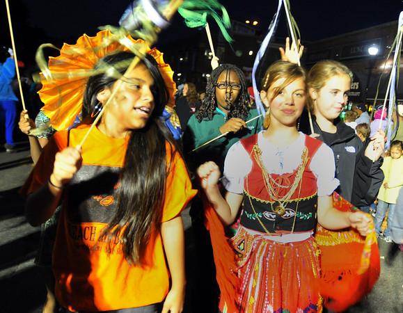 Salem:  Ruby Cheresnowsky, left, and Briana Pinto parade with the Salem Academy Charter School. photo by Mark Teiwes / Salem News