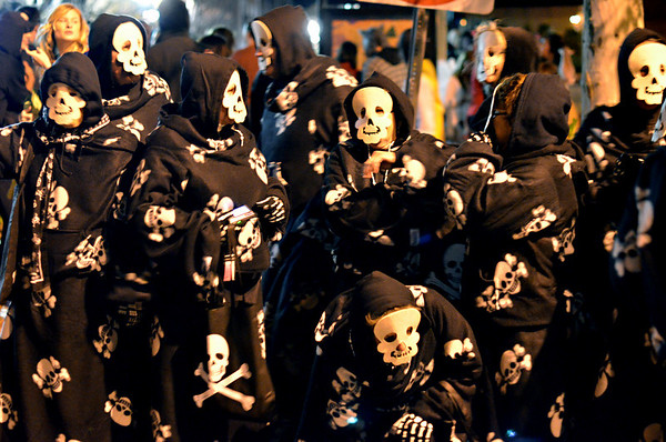 Saturday night scenes Halloween weekend in Salem:  Friends from the Salem Willows neighborhood came downtown all wearing skeleton snuggies.  photo by Mark Teiwes / Salem News.