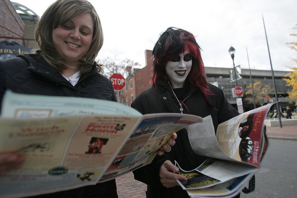 Sarah Newhall from New Jersey and Allie DiVito of Arlington check out a brochure to see what was happening in Salem on Friday while walking down Essex Street. Photo by deborah parker/october 29, 2010