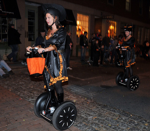 Salem:  Amy Doolin rolls up Front St. with Witch City Segway. photo by Mark Teiwes / Salem News