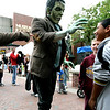 Salem: Frankenstein was scene roaming around pedastrian mall on Monday, with things full swing in Salem, tourist are enjoying the activities of Salem. Photo by Mark Lorenz/Salem News