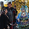 Salem: Emily Kiesiner, left, and Derek Brooke, both from Millbury walk in elaborate costumes with Chelsea Stoddard of Coventry, RI. photo by Mark Teiwes / Salem News
