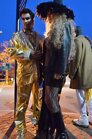 Salem: Springs Toledo of Plymouth and Karen Henry of Canton walk around dressed as Elvis and a gothic witch on their way to Strega for dinner.  They said they liked the characters in Salem and to be characters. photo by Mark Teiwes / Salem News