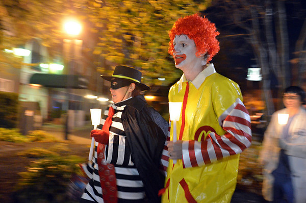 Salem: Marcia and Mark Fritsche of Brookfield MA walk with a ghost tour.  photo by Mark Teiwes / Salem News