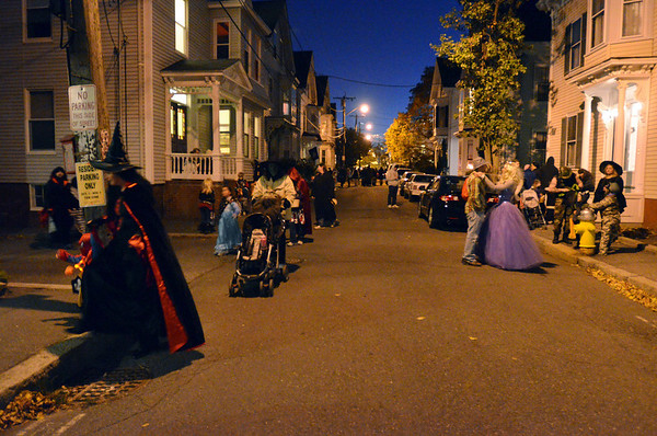 Salem:  Families stroll down Boardman St. away from the crowds downtown while trick-or-treating Sunday evening.