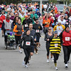 Salem:   Jill and Jonathan Davis, right, of Salem run as a Honey bee and lady bug in the 10th annual Witch City 5K road race sponsored by Salem YMCA at the Salem Willows.  photo by Mark Teiwes / Salem News