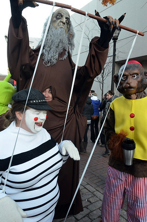 Salem: Darleen Withham, left, walks as a marionette with her husband Joshua as the puppet master and her brother-in-law Jordan as the organ grinder. photo by Mark Teiwes / Salem News
