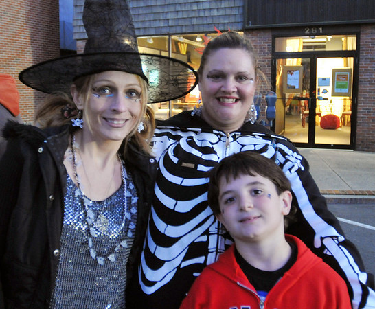 Salem:  Angie Nazzaro, left, Sarah Trow and JD Rush at the 15th annual Haunted Happenings Grand Parade. photo by Mark Teiwes / Salem News