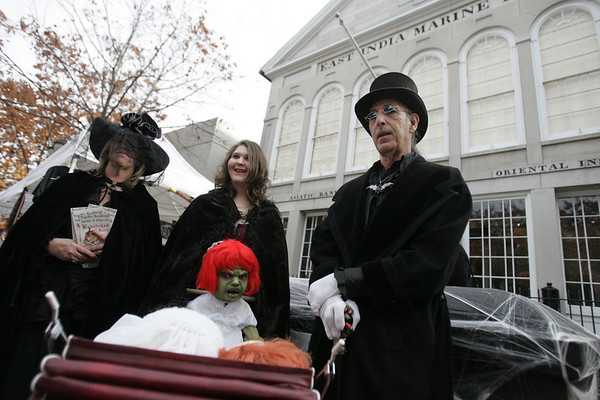 The Recupero family of Peabody, Carole, Hollyann and Bob, attracted a crowd with their unique costumes and props while standing in front of the Peabody Essex Musuem on Essex Street Friday afternoon. Photo by deborah parker/october 29, 2010