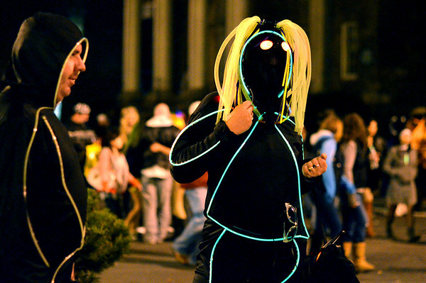 Saturday night scenes Halloween weekend in Salem:  Dennis Howes, left, and Jody Thereault, both of Ipswich wore flashing glow-in-the-dark costumes.    photo by Mark Teiwes / Salem News.