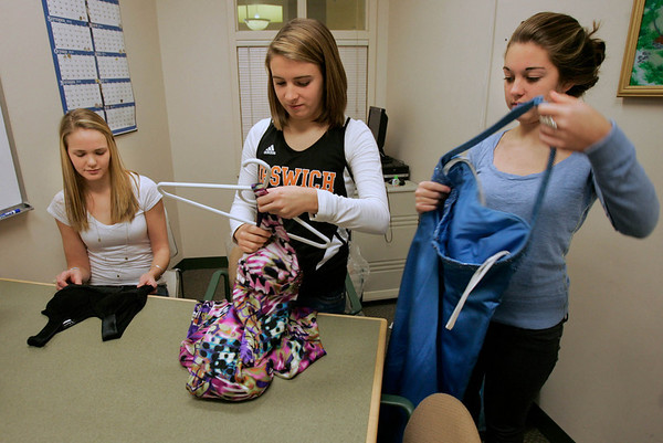 Ipswich: Ipswich high SChool juniors, Alex Sulkin, Paige Sirois and Morgan Riddle with donated prom dresses, which will be resold for $20.00. Photo by Mark Lorenz/Salem Newsv