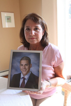 Salem: Ann DeLuca holds a photograph of her son, Peter who commited suicide in 2007. She will be walking 20 miles in one night this weekend for the Out of the Darkness Overnight Experience in Boston. She will be raising money and awareness for suicide prevention.<br /> Photo by Cole Margen/ Salem News June 24, 2010<br />  , Salem: Ann DeLuca holds a photograph of her son, Peter who commited suicide in 2007. She will be walking 20 miles in one night this weekend for the Out of the Darkness Overnight Experience in Boston. She will be raising money and awareness for suicide prevention.<br /> Photo by Cole Margen/ Salem News June 24, 2010