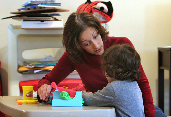 Peabody: Lisa Waxman with her son, Brady at play together at their Peabody home. Lisa survived severe postpartum depression and recently testified on Beacon Hill in favor of a bill that would make Massachusetts the first state in the country to mandate screening for postpartum depression. Photo by Mark Lorenz/Salem News<br /> , Peabody: Lisa Waxman with her son, Brady at play together at their Peabody home. Lisa survived severe postpartum depression and recently testified on Beacon Hill in favor of a bill that would make Massachusetts the first state in the country to mandate screening for postpartum depression. Photo by Mark Lorenz/Salem News