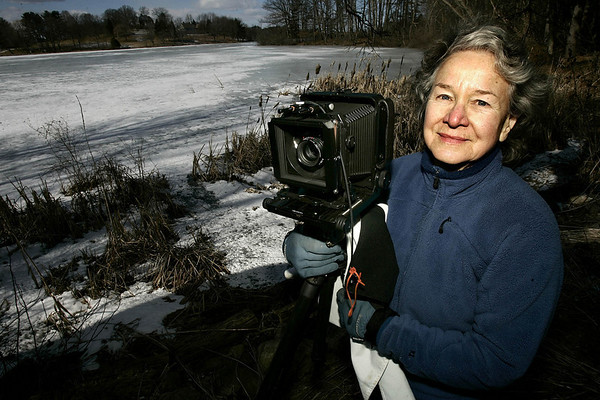 """Ipswich: Dorothy Kerper Monnnelly of Ipswich, at her Ipswich home, recently had her book published, """" Between Land and Sea: The Great Marsh, """" a collection of her photographs taken in Ipswich. Dorothy , with her Toyo large format camera, that she uses. Photo by Mark Lorenz/Salem News Friday, February 09, 2007"""