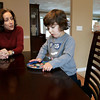 Peabody: Lisa Waxman and her son, Brady take time in the morning to enjoy a snack. Lisa, who survived severe postpartum depression recently testified on Beacon Hill in favor of a bill that would make Massachusetts the first state in the country to mandate screening for postpartum depression. Photo by Mark Lorenz/Salem News