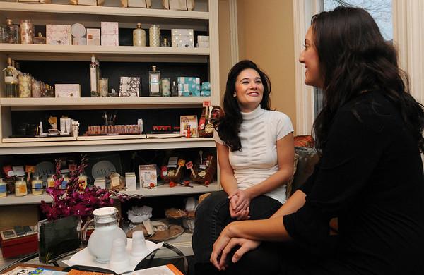 "Wenham:<br /> Maria Lekkakos, left, owner of M. Lekkakos salon, speaks with Christy Flanagan, stylist and make up artist, near the ""beauty bar"" at the business.<br /> Photo by Ken Yuszkus/Salem News,  Wednesday,  November 17, 2010."