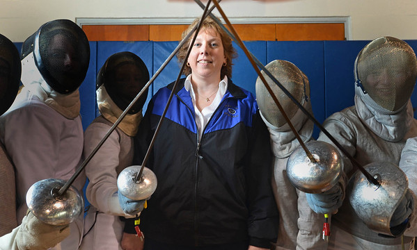 Danvers: Jane Hall Carter, fencing coach with members of her team.  photo by Mark Teiwes / Salem News