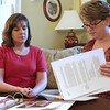 Salem: Julie A. Manninen, left and Christina Woolhiser, look over paper work, during a meeting at Sarah Morrill's home in Salem. Julie is the first-ever Executive Director of the Salem Education Foundation, a local nonprofit. Christina is the administrative assistant. Photo by Mark Lorenz/Salem News<br /> , Salem: Julie A. Manninen, left and Christina Woolhiser, look over paper work, during a meeting at Sarah Morrill's home in Salem. Julie is the first-ever Executive Director of the Salem Education Foundation, a local nonprofit. Christina is the administrative assistant. Photo by Mark Lorenz/Salem News