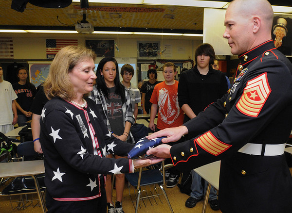 Peabody:<br /> Abbie Gore, left, history teacher at Peabody Veterans Memorial High School, receives a U.S. flag flown in Afghanistan from Sgt. major William Wells of the U.S. Marines Thursday afternoon.<br /> Photo by Ken Yuszkus/Salem News, Thursday,  October 28, 2010.<br /> , Peabody:<br /> Abbie Gore, left, history teacher at Peabody Veterans Memorial High School, receives a U.S. flag flown in Afghanistan from Sgt. major William Wells of the U.S. Marines Thursday afternoon.<br /> Photo by Ken Yuszkus/Salem News, Thursday,  October 28, 2010.