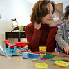Peabody: Lisa Waxman, who survived severe postpartum depression watches her son, Brady pay with Silly-Puddy. Lisa recently testified on Beacon Hill in favor of a bill that would make Massachusetts the first state in the country to mandate screening for postpartum depression. Photo by Mark Lorenz/Salem News<br /> , Peabody: Lisa Waxman, who survived severe postpartum depression watches her son, Brady pay with Silly-Puddy. Lisa recently testified on Beacon Hill in favor of a bill that would make Massachusetts the first state in the country to mandate screening for postpartum depression. Photo by Mark Lorenz/Salem News