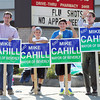 Beverly: Beverly Mayoral candidate Mike Cahill, left, waves to passing cars outside the Walgreens on the corner of Rantoul and Elliott Streets on Saturday morning with his nephews Justin, 10, Aidan, 12, and his brother Tim Cahill. David Le/Salem News