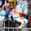 Topsfield:<br /> Henry Lahann, 2, is held by his father Randall of Tewksbury, while riding the carouselle at the Topsfield Fair. Henry's brother Rory rode as well. <br /> Photo by Ken Yuszkus, The Salem News, Monday, October 07, 2013.