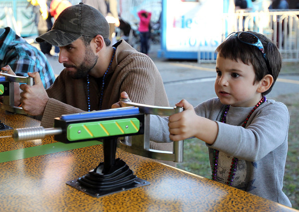 Salem: Four-year-old Nikolas Strauss, of Peabody, intently concentrates while playing a water gun race game at the Salem Haunted Happenings Carnival on Derby Street in Salem on Friday afternoon. David Le/Salem News