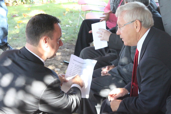 Peabody Mayor Ted Bettencourt, left, goes over the agenda with former Mayor Mike Bonfanti before the official groundbreaking for the Main Street Corridor Realignment project Tuesday, Oct. 16. <br /> Staff photo by Alan Burke