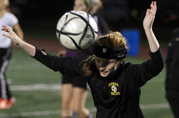Peabody: Bishop Fenwick freshman Emily Smith goes through a head ball drill at practice on Tuesday evening. Several Crusaders players wear special headbands that help prevent concussions. David Le/Salem News