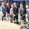 Several city and state officials had the honors of ceremoniously breaking ground on the Peabody Main Street Corridor Realignment project Oct. 16. From left are Peabody School Committee member Jarrod Hochman, City Councilor Barry Osborne, City Councilor Tom Gould, Peabody Chamber of Commerce Executive Director Deanne Healey, Mayor Ted Bettencourt, Lt. Gov. Tim Murray, City Councilor Dave Gravel, former Mayor Mike Bonfanti, state Senate candidate Joan Lovely and state Rep. Ted Speliotis.<br /> Staff photo by Alan Burke