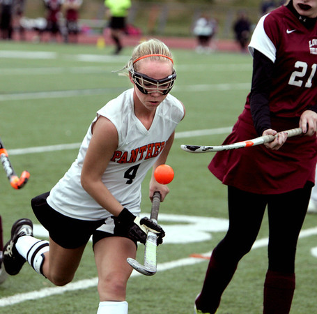 Beverly:<br /> Beverly's Nicole Woods controls the ball by bouncing it off her stick several times during the Lowell at Beverly High field hockey in Division 1 North playoffs.<br /> Photo by Ken Yuszkus / The Salem News, Thursday, October 31, 2013.