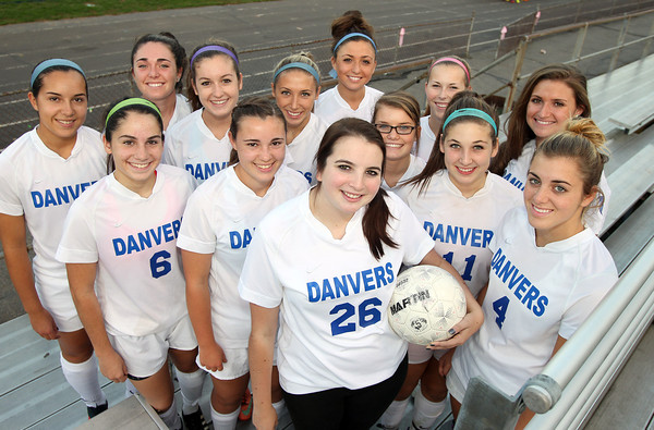 Danvers: Danvers High School senior Nicole Harrison (26), center, has been the team manager for the Falcons girls varsity soccer team for over two years. She was diagnosed with cystic fibrosis when she was 5 years old, and to show their support for their teammate, the Danvers Girls Soccer team will hold a cystic fibrosis awareness night for her on Saturday evening. Harrison is surrounded by her classmates: Kasey Nestor, Cate Raftery, Erin Loehner, Leah Ciampa, Nicole Belanger, Ashley Arnoldy, Courtney Arnoldy, Delaney Zecha, Kylie Plaza, Stephanie Kowalski, Kaitlyn Bates, and Caitlin Tivnan. David Le/Salem News