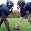 Middleton: North Shore Tech sophomore DT/OT Brent Campbell, left, and sophomore C/DE Bryan Raustead, right, have been big contributors on both sides of the ball for the Bulldogs this fall. David Le/Salem News