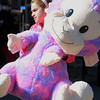 Topsfield:<br /> Francesca Rubino, 11, carries a stuffed animal that she won, which is almost the same size as her, at the Topsfield Fair on the last day of the fair.<br /> Photo by Ken Yuszkus, The Salem News,  Monday, October 14, 2013.