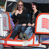 Topsfield:<br /> Denise Landry, left, and friend Debbie Williams ride one of the rides  at the Topsfield Fair on the last day of the fair.<br /> Photo by Ken Yuszkus, The Salem News,  Monday, October 14, 2013.