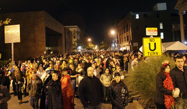 A large number of people gathered along Washington St. to watch the fireworks, signaling the end of Halloween Night in Salem. David Le/Staff Photo.