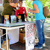 Salem:<br /> From left, Stacia Cooper from Destination Salem and Jennifer Close of Peabody Essex Museum give info and directions to tourist Candy Zierle of Michigan at the information tent set up near the Visitors Center which is closed.<br /> Photo by Ken Yuszkus, The Salem News, Tuesday, October 01, 2013.