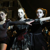Salem: From left, Alison Roberts, 15, Katelin Redford, 14, and Miriam Joyce, 15, from Dance Enthusiasm dance in front of the spectators platform just outside Salem Common on Thursday evening. David Le/Salem News