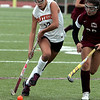 Beverly:<br /> Beverly's Kate Silvestri keeps the ball under her control during the Lowell at Beverly High field hockey in Division 1 North playoffs.<br /> Photo by Ken Yuszkus / The Salem News, Thursday, October 31, 2013.